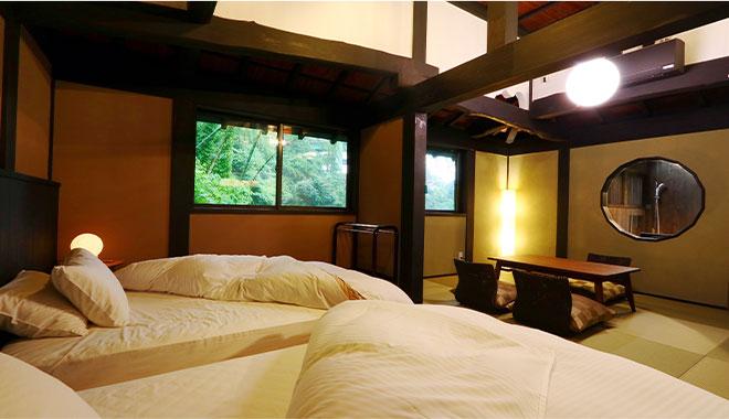 寝室はシモンズ製のツインベッドタイプ